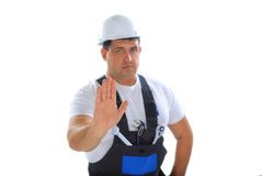 Builder making stop sign Royalty Free Stock Image