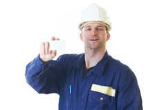 Builder man in blue robe with visit card Stock Photography