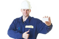 Builder man in blue robe with visit card Royalty Free Stock Photography