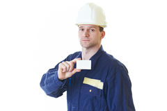 Builder man in blue robe with visit card Royalty Free Stock Images