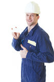 Builder man in blue robe with visit card Stock Image