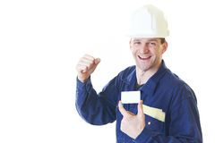 Builder man in blue robe with visit card Stock Photos