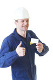 Builder man in blue robe with visit card Stock Images