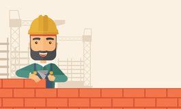 Builder man is building a brick wall. Stock Images