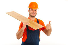 Builder man carrying wood plank Royalty Free Stock Photography