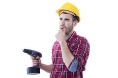 Builder man construction with drill. Thoughtful man with drill isolated on white background Royalty Free Stock Images