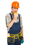 Builder man eating sandwich in a break Royalty Free Stock Image