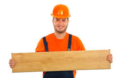 Builder man holding plank Royalty Free Stock Photo