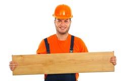 Builder man holding plank Royalty Free Stock Photo