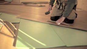 Builder man Install Laminate Floor stock video footage