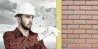 Builder man with level Royalty Free Stock Photography