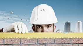 Builder man with level Stock Image