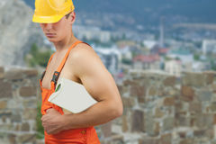 Builder man in protective helmet Stock Image