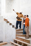 A builder with a man and woman Royalty Free Stock Image
