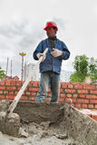 Builder man works with shovel at construction site Royalty Free Stock Images