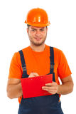 Builder man write to a clipboard Royalty Free Stock Image