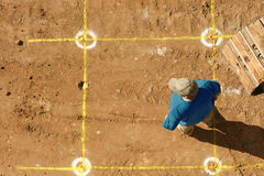 Builder and markings. Builder stands by markings for the dig Royalty Free Stock Images