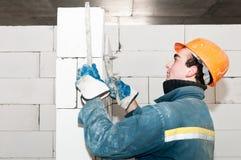 Builder mason at bricklaying work Royalty Free Stock Photography