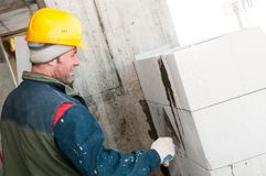 Builder mason at bricklaying work Stock Photography