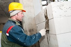 Builder mason at bricklaying work Royalty Free Stock Photo