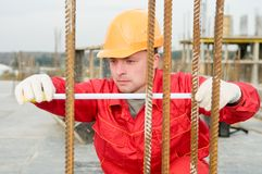 Builder with measure tape Royalty Free Stock Photo