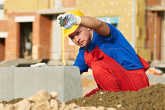 Builder with measure tape Royalty Free Stock Photography