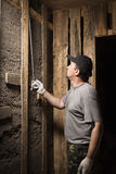 Builder measures the height of the tape Royalty Free Stock Photography