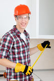 Builder measures the length Stock Photos