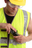 Builder with measuring device Royalty Free Stock Image