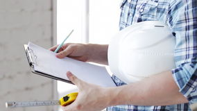 Builder with measuring tape on site Stock Photography