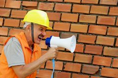 Builder with a megaphone Royalty Free Stock Photos