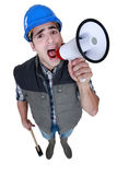 Builder with megaphone Royalty Free Stock Photo