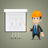 Builder men points on flipchart Royalty Free Stock Photos