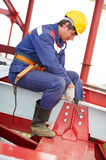 Builder millwright worker at construction site Stock Images