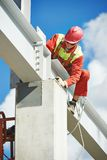 Builder millwright worker at construction site Royalty Free Stock Photos