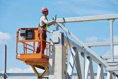 Builder millwright worker at construction site Royalty Free Stock Images
