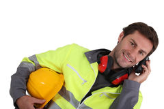 Builder on mobile phone. Builder making call on mobile phone Royalty Free Stock Images
