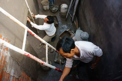 Builder mortar at underground civil works Stock Photo