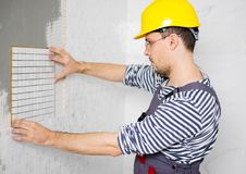 Builder in new apartment Royalty Free Stock Photo