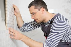 Builder in new apartment Royalty Free Stock Photography
