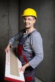 Builder in new apartment Stock Photos