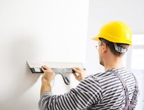 Builder in new apartment Royalty Free Stock Image