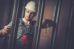 Builder in new apartment Stock Photography