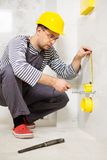 Builder in new apartment Stock Photo