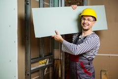 Builder in new apartment Stock Images
