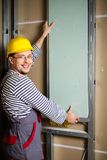 Builder in new apartment Stock Image