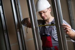 Builder in new building interior Royalty Free Stock Photography