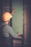 Builder in new building interior Stock Image