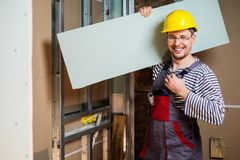 Builder in new building interior royalty free stock images