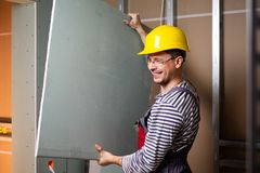 Builder in new building interior Stock Photography